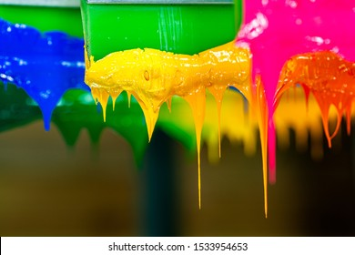 several dripping colors ink on handle printers in tee shirt factory hang on the storage