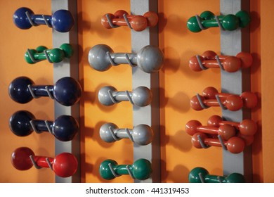 Several dumbbells weights in gym