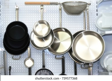 Several empty  frying pans on a white  background .