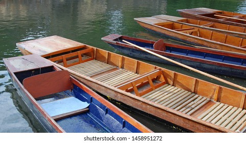 Several empty river punts moored on the River Cam, Cambridgeshire, UK