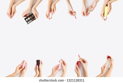 several female hands with open makeup in their hands. Copy space. Daily care for yourself. Face care product. Banner of woman`s cosmetics on white background. Girl`s morning skin care. Make up
