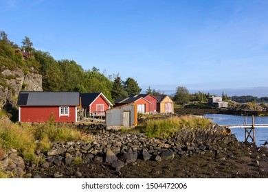 Several fishermen's cabins and boathouses by the sea. A typical Norwegian coastal landscape. Seen here near Alversund, on the island of Radoy, near Bergen.