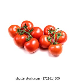 several fresh tomatoes with green leaves isolated on a white background. Juicy red tomatoes. Ripe vegetables. Organic product.