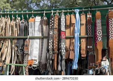 Several gaucho belts and horseriding accessories for sale at a fair in Rosario city, Argentina