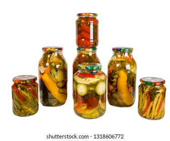 Several glass jars with canned vegetables. Isolated on white background. Homemade blanks.