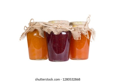 Several glass jars of red and yellow jam, the lid on top is tied with a coarse cloth and hemp rope. Isolate on white background.