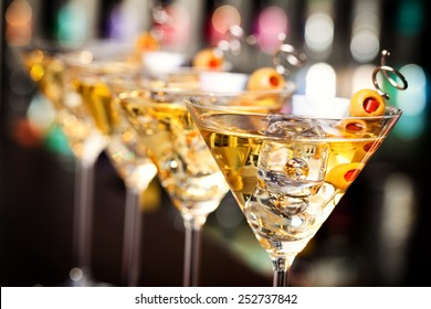 Several glasses of famous cocktail Martini, shot at a bar with shallow depth of field