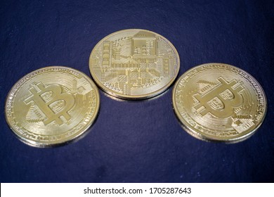 several gold coins cryptocurrency money bitcoin on a black background
