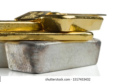 Several gold and silver bars of different weight isolated on a white background.