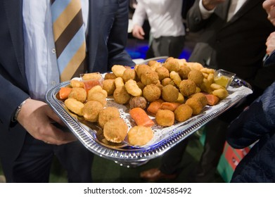 Several greasy snacks served on a plate