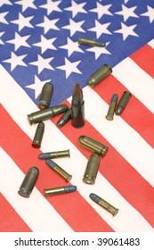several gun and rifle ammunition of american flag