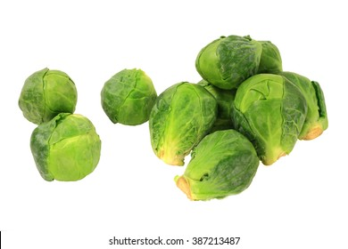 Several Heads (Bulbs) of Organic Vegetable Brussels sprout (Cabbage) on pile and singles isolated over white background