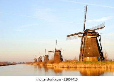 Several historical windmills in a row.