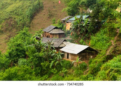 Several homes built on slopes of the limestone and granite mountains of Ha Giang, Vietnam.