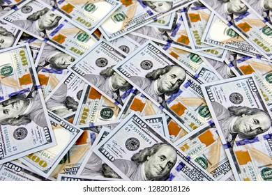 Several Hundred dollar bills make a cash background