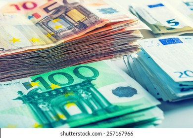 Several hundred euro  banknotes stacked by value.