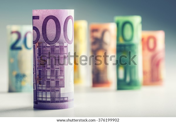 Several hundred rolls of euro banknotes in different positions.