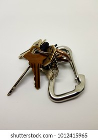 Several keys on a keychain on white background.