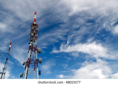 Several kind of communication antennas and red and white towers