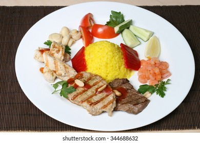 several kinds of meat with rice and vegetables