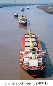 Several large cargo ships on the Mississippi River