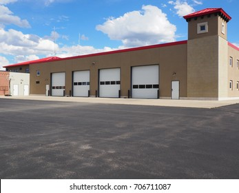 Several large closed garage doors for a small warehouse.