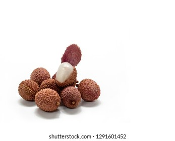 Several lychee fruits, one with open peel