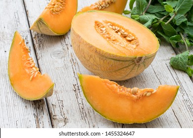 several melons cut into slices