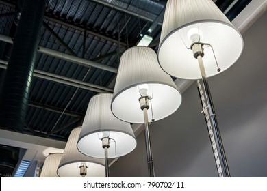 Several modern standing lamps in shop