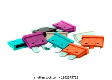 several multi-colored car fuses for the fuse box  replacing the electric  fuses in