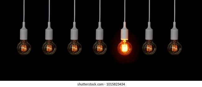 Several not particularly bright lamps against a dark background.