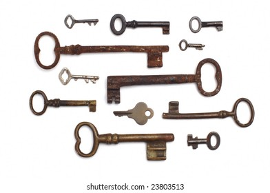 several old keys isolated at white