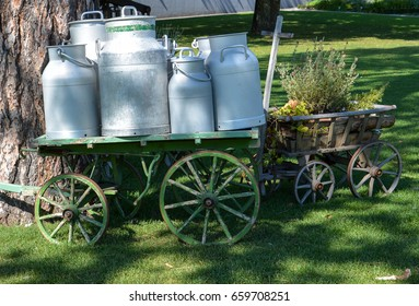 "Several old milk churns on a wagon at the ""Gurten"" in Bern in the sun"