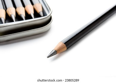 several pencils in a tin isolated on a white background