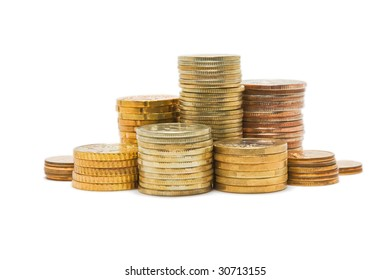 Several piles of coins isolated on white