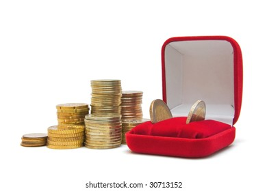 Several piles of coins and jewelry box isolated on white