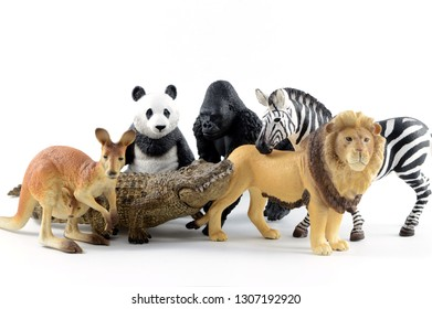 Several plastic toy animals together over a white background.