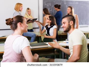 Several positive students communication sitting in the classroom