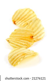 Several potato chips isolated on white background