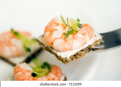 Several prawn canapes with soft front and backgrounds