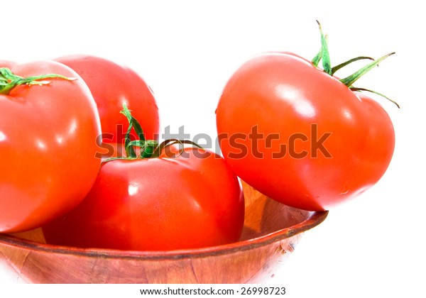 several red and big tomato in bowl. isolated.