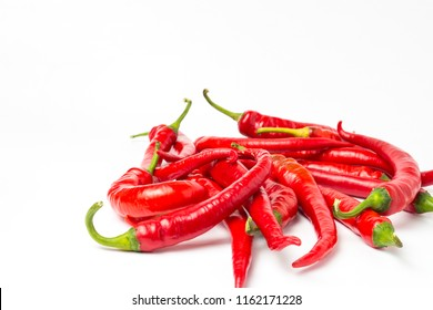 Several red hot chili peppers on a white background