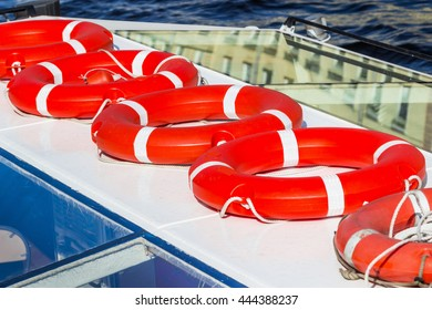 Several red lifebuoys placed on the boat.