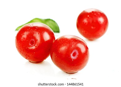 several red ripe plums in a spray of water, photo on the white background.
