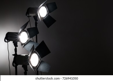 Several reflectors on the black background in photo studio. ready to do professional shooting
