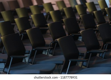 Several rows of empty plastic chairs in the audience prepared for the speaker's speech in front of students or journalists and spectators. Modern audiences for Lectures, seminars to listeners.