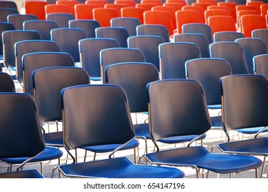 Several rows of plastic chairs for spectators