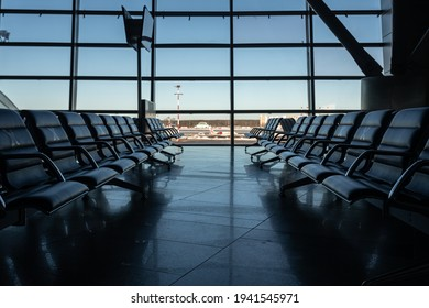 Several rows of seats in the airport's international terminal are completely empty. There are no passengers at the airport . No people at the airport during the covid 19 coronavirus pandemic.
