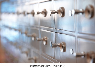 Several safes. Horizontal, closeup view with shallow depth of field