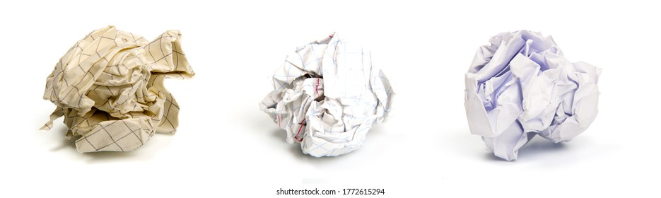 several sheets of crumpled discarded paper isolated on a white background